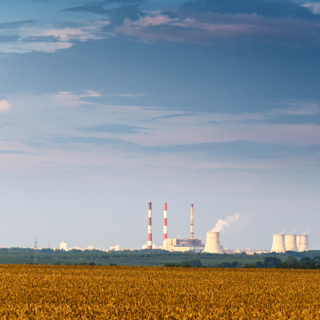 """Panoramic view of Nuclear power plant with golden wheat field"" stock image"