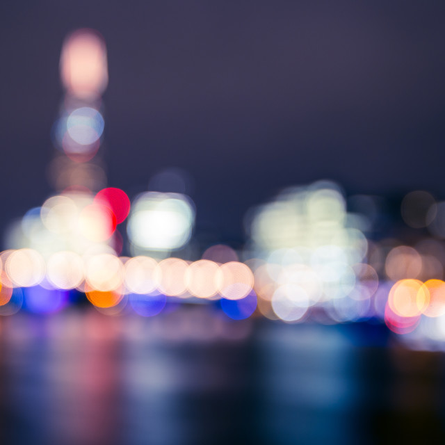 """London blurred bokeh skyline at night on River Thames"" stock image"