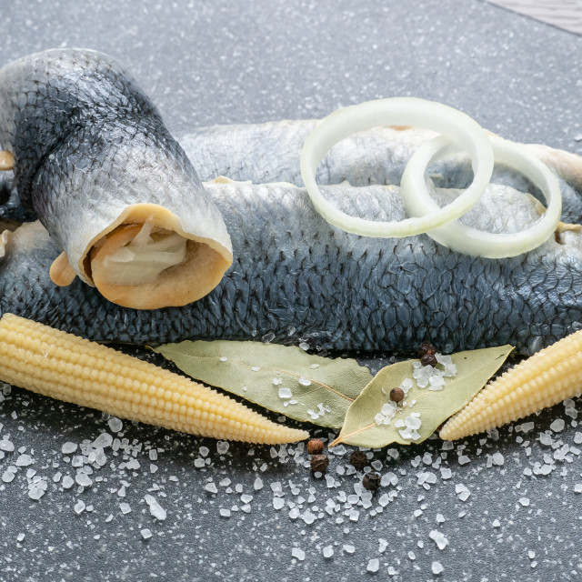 """Saltwater marinated fish, cold appetizer. Herring fillet marinated on black..."" stock image"