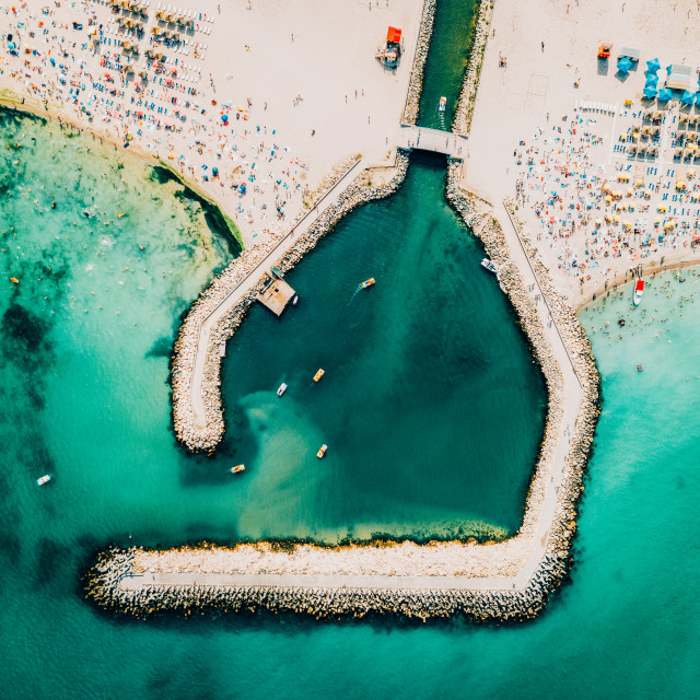 """""""Aerial Drone View Of Concrete Pier On Turquoise Water At The Black Sea Resort Costinesti In Romania"""" stock image"""