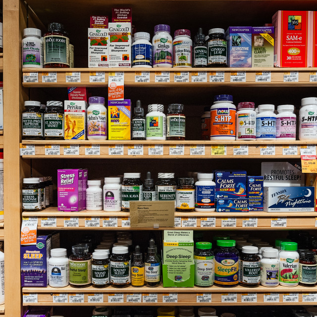 """Display of vitamin and supplement products in a health food store"" stock image"
