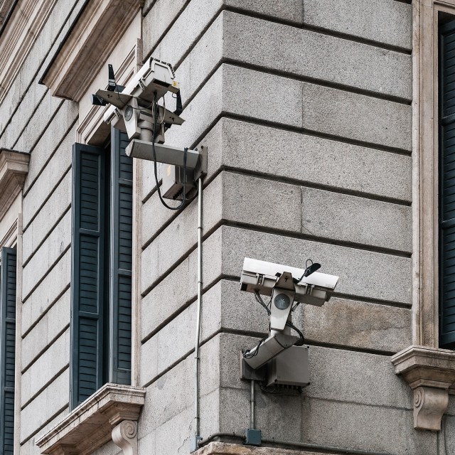 """Security video cameras mounted on building exterior, Madrid, Spain"" stock image"
