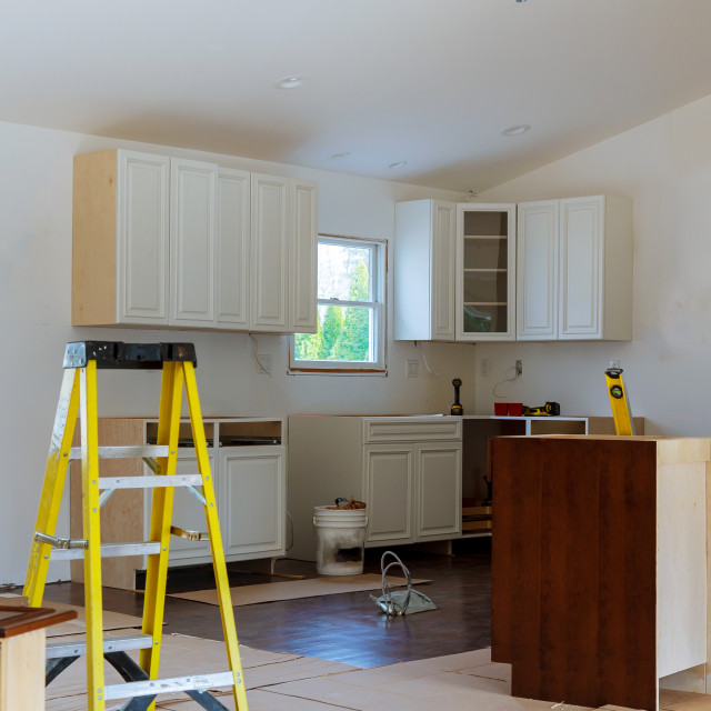"""""""Installation of kitchen cabinet."""" stock image"""