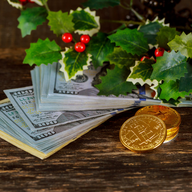 """""""Golden bitcoin coins on a paper dollars money Virtual currency."""" stock image"""