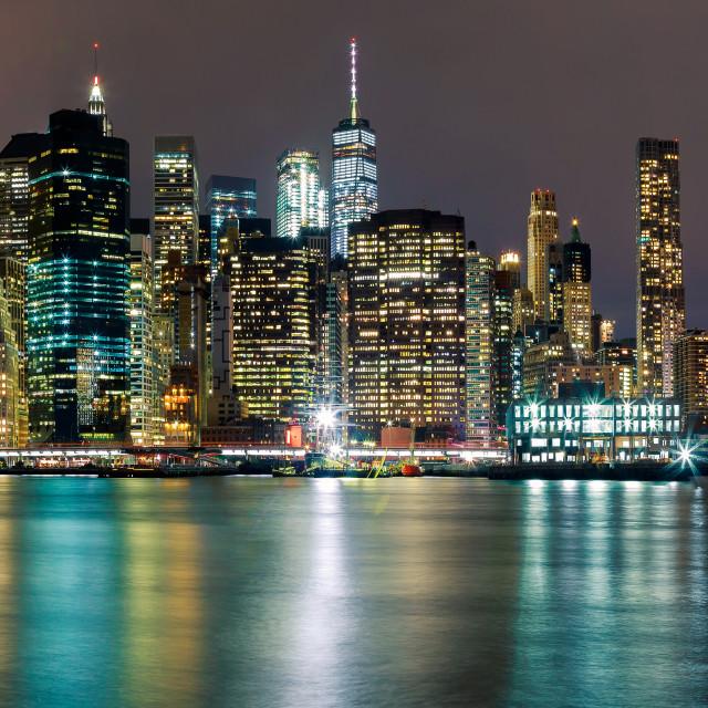 """Brightly colorful fireworksNew York City manhattan buildings skyline night..."" stock image"