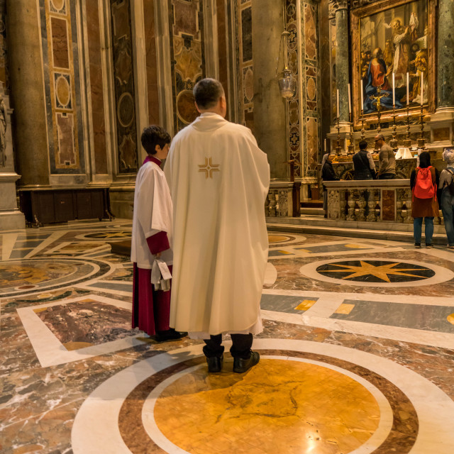 """St. Peter's basilica priest and alter boy"" stock image"