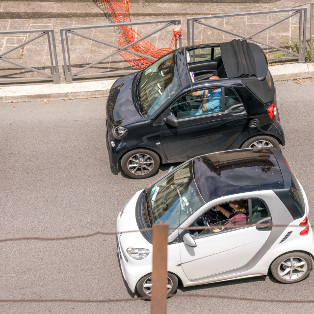 """Two smart cars in traffic in Rome"" stock image"