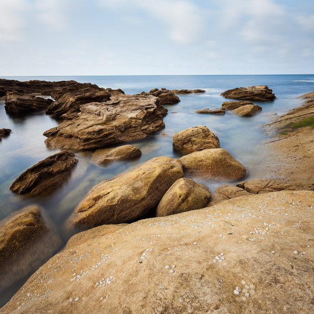 """Landscape of rocks and sea"" stock image"