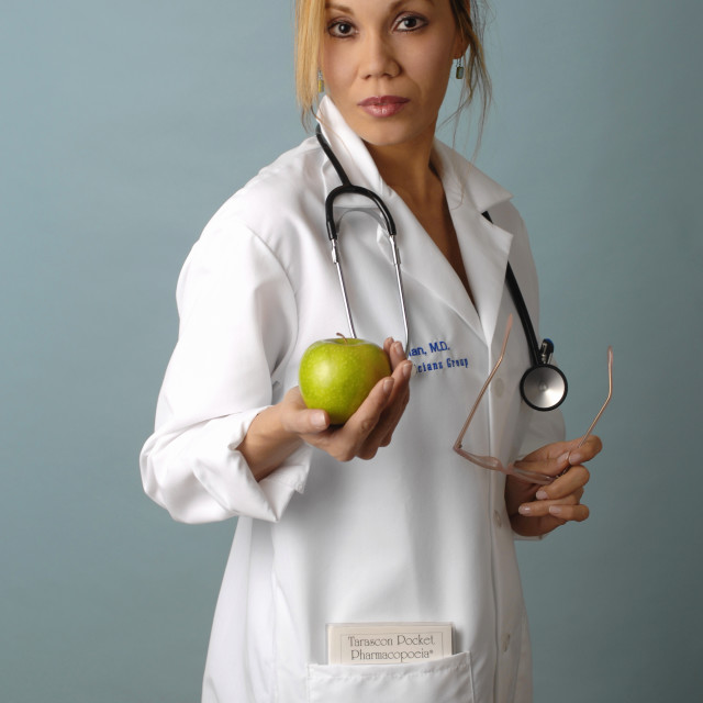 """Doctor In Her Smock"" stock image"