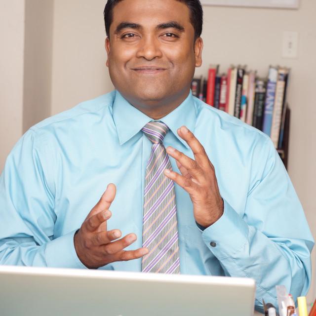 """Indian Man At Work"" stock image"