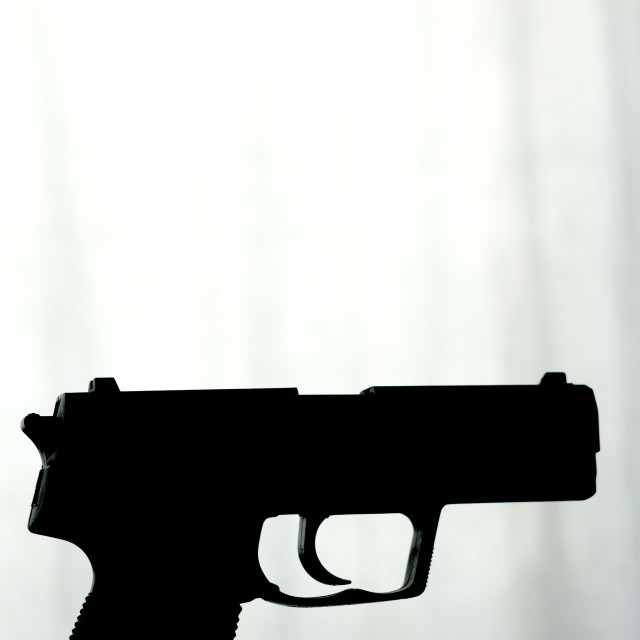 """""""Firearm in silhouette"""" stock image"""