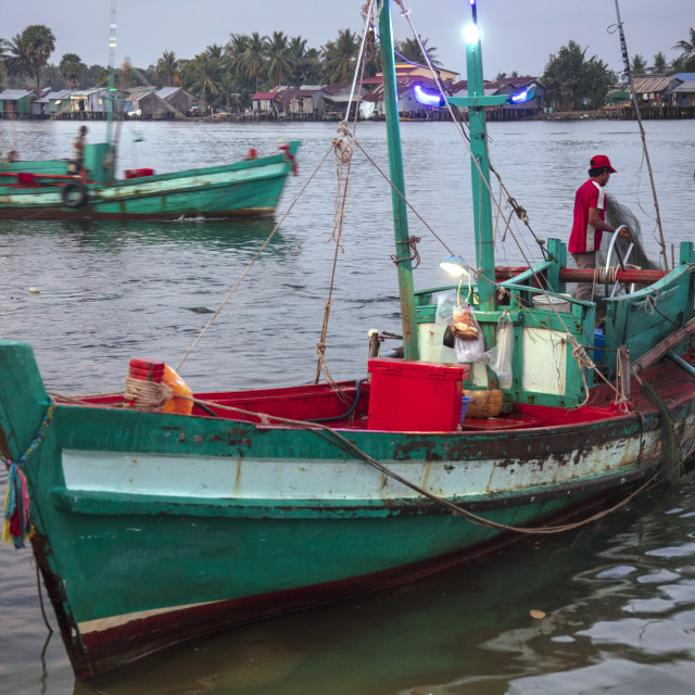 """Fishing boat at the morning fish market on the banks of the Preaek Tuek Chhu..."" stock image"