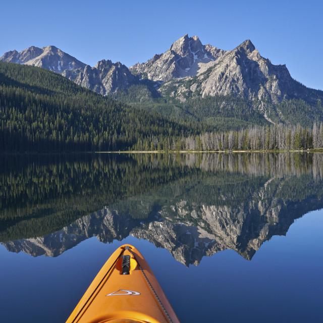 """McGown Peak reflected in Stanley Lake while kayaking, Sawtooth National..."" stock image"