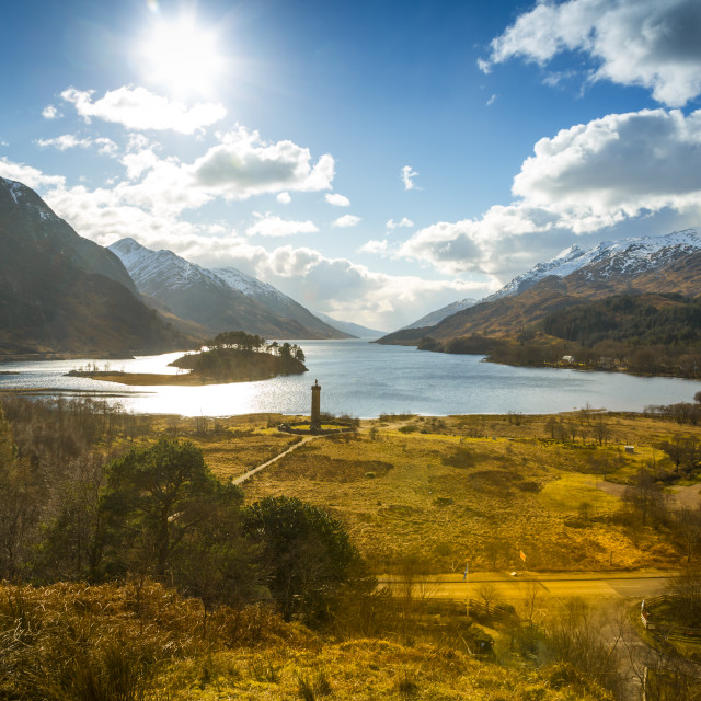 """Sunshine and The Glenfinnan Monument beside Loch Shiel, Highlands, Scotland,..."" stock image"