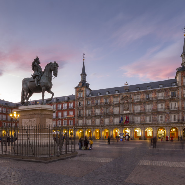 """""""View of Philip lll statue and architecture in Calle Mayor at dusk, Madrid,..."""" stock image"""