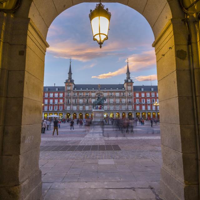 """View of Casa de la Panaderia in Plaza Mayor through archway at dusk, Madrid,..."" stock image"