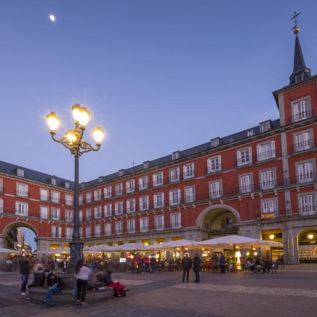 """View of restaurants in Plaza Mayor at dusk, Madrid, Spain, Europe"" stock image"