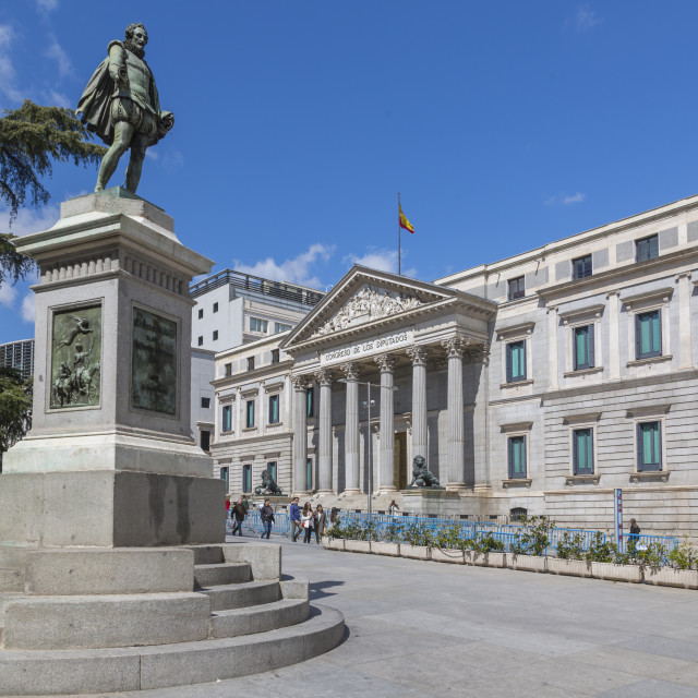 """View of Michaeli de Gervantes statue and Congress in Plaza de las Cortes,..."" stock image"