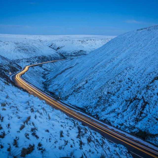 """Winter landscape & trail lights on Snake Pass, Peak District National Park,..."" stock image"