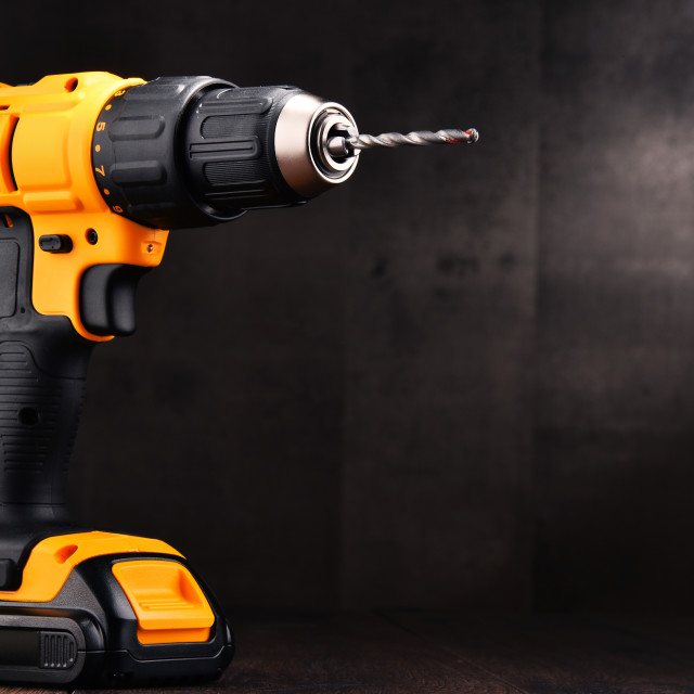 """""""Cordless drill with drill bit working also as screw gun"""" stock image"""
