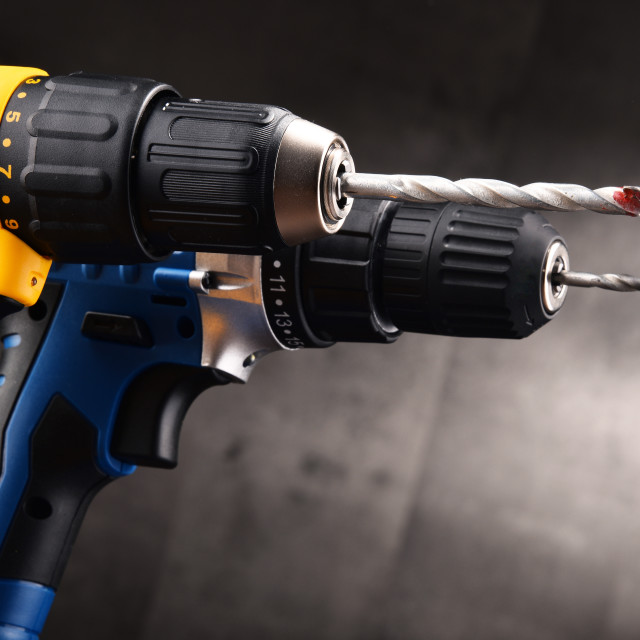 """""""Two cordless drills with drill bits working also as screw guns"""" stock image"""