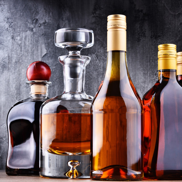 """""""Carafe and bottles of assorted alcoholic beverages."""" stock image"""