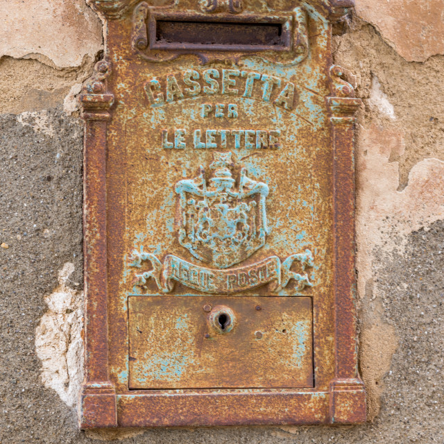 """""""A rusty old mail box embedded in a wall"""" stock image"""