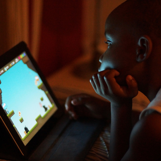 """""""A Little Boy Playing On iPad"""" stock image"""