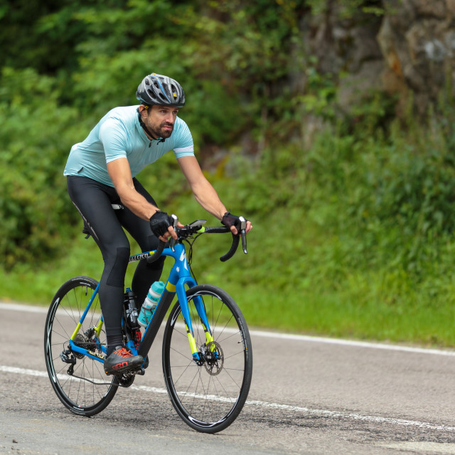 """Cyclist speeding on a fast road bike"" stock image"