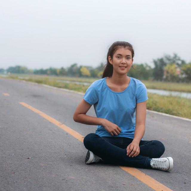 """Girl is sitting on street."" stock image"