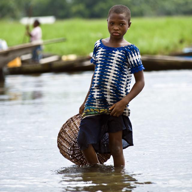 """Girl with fish basket, Ganvie, Benin."" stock image"