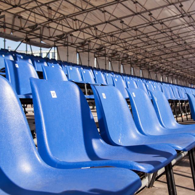 """plastic blue seats in a stadium"" stock image"