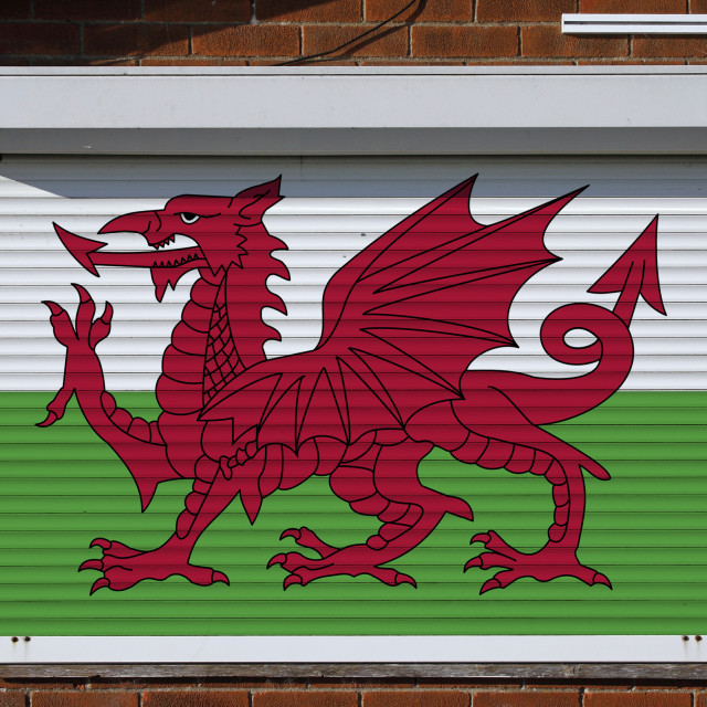 """""""Wales flag on closed security shutters"""" stock image"""