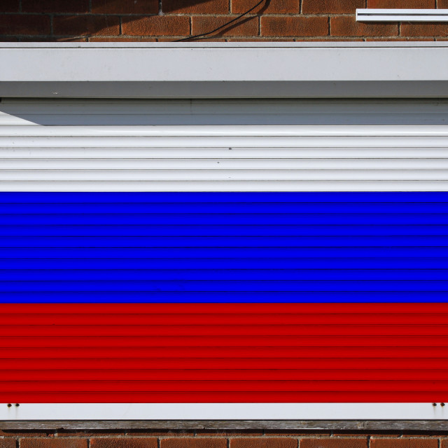 """""""Russia flag on closed security shutters"""" stock image"""