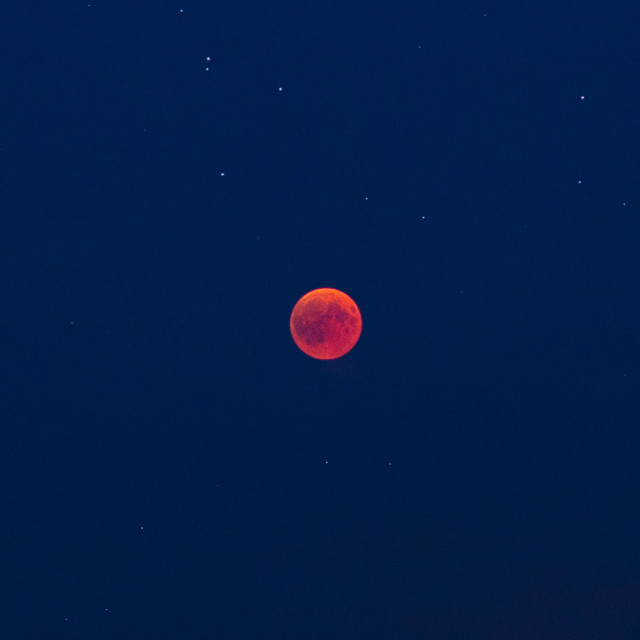 """Red moon and stars during the lunar eclipse"" stock image"