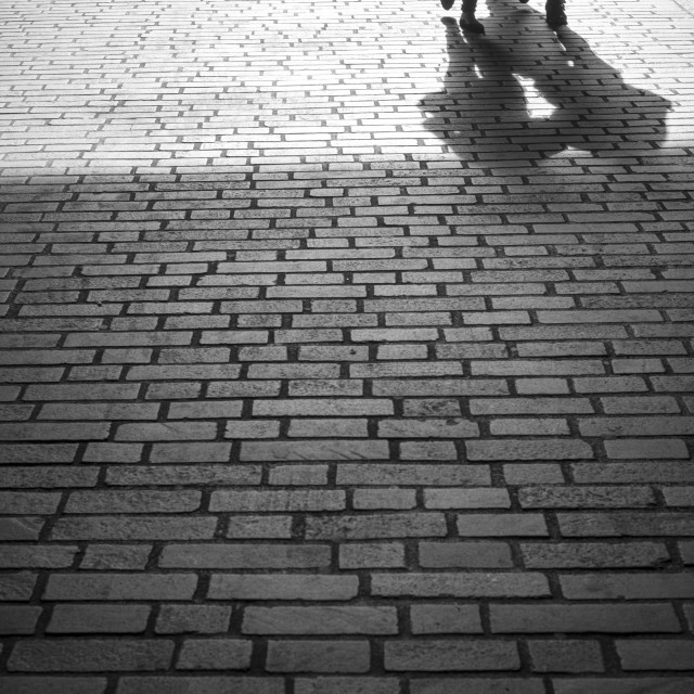 """walking down a cobbled lane"" stock image"