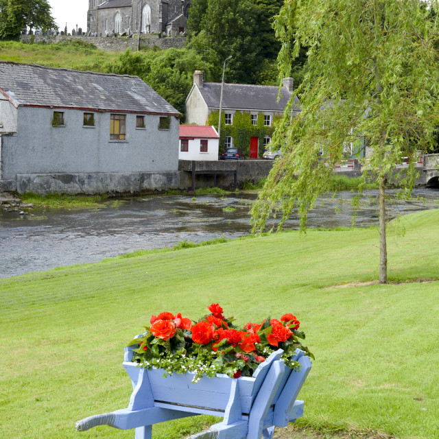 """""""wheel barrow flowers at castletownroche park and church"""" stock image"""