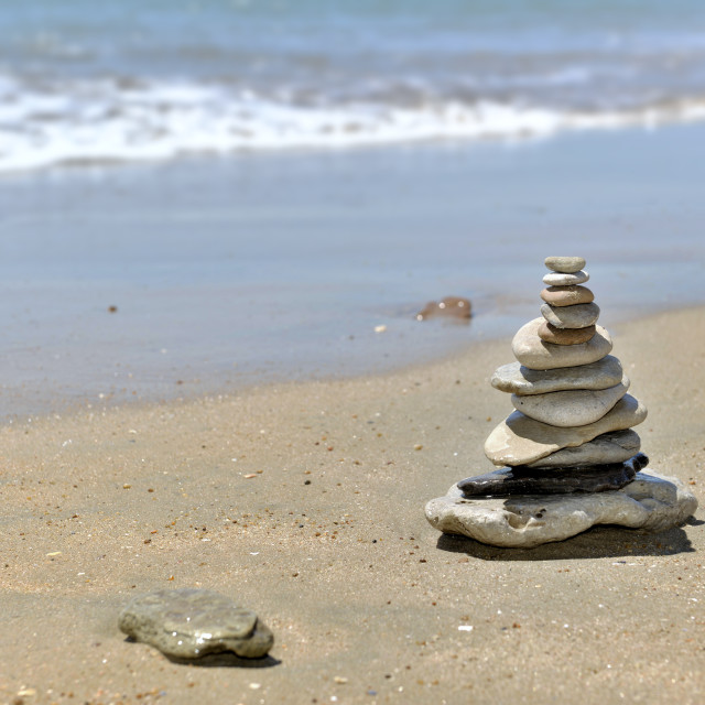 """""""Pebbles piled on the sand"""" stock image"""