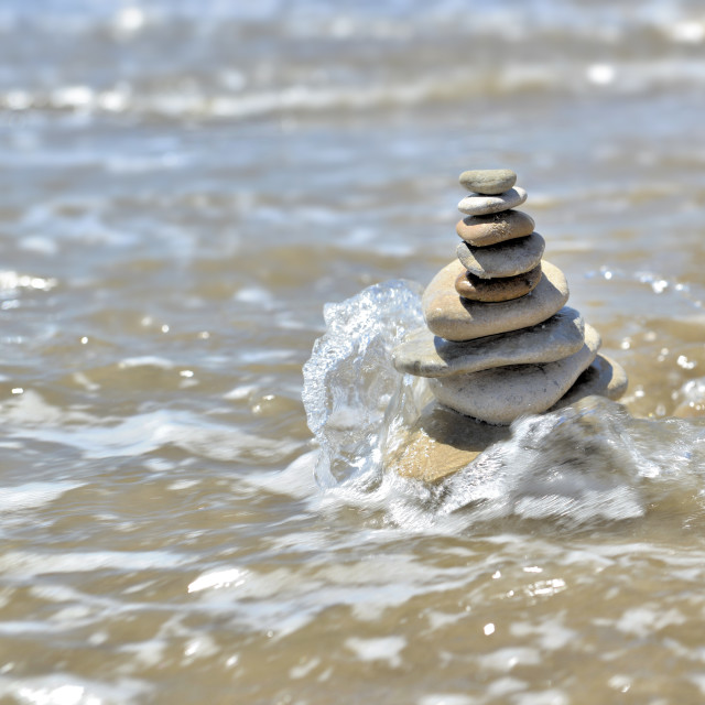 """""""stack of pebbles in the sea"""" stock image"""