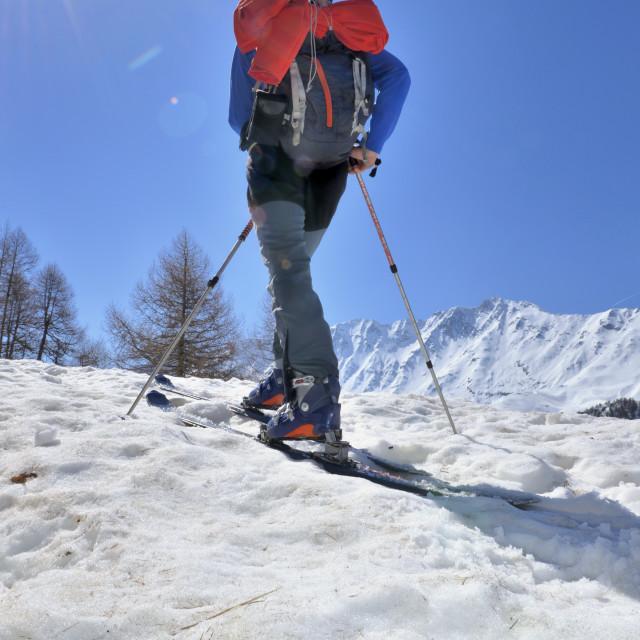 """Ski touring under sunny sky"" stock image"
