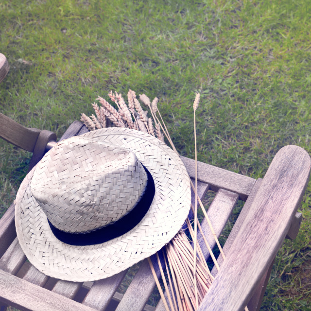 """""""countryside chair with hat"""" stock image"""