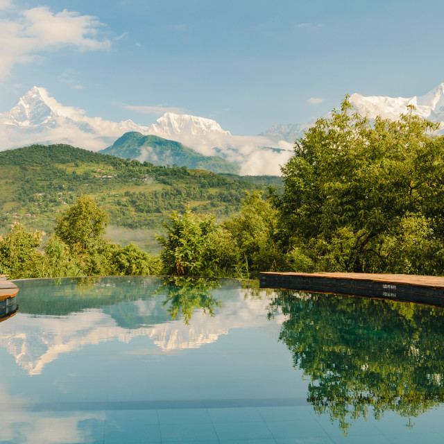 """Annapurna mountain range reflecting in an infinity pool in a resort, Pokhara,..."" stock image"