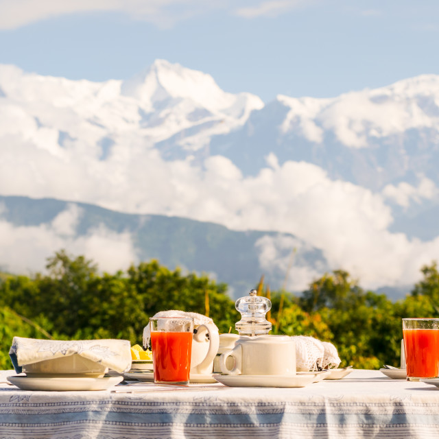 """""""Breakfast table with coffee, tea and watermelon juice dressed in front of the..."""" stock image"""