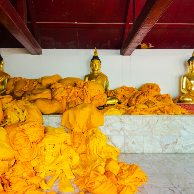 """""""Drapes and fabric are piled up to be washed in the Thai buddhist temple of..."""" stock image"""