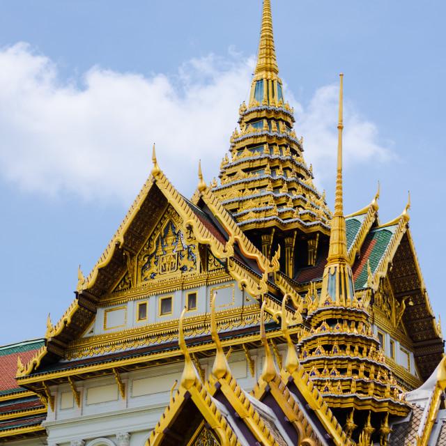 """Detail of Bangkok's Royal Palace rooftops, with gilded wood and naga figures,..."" stock image"