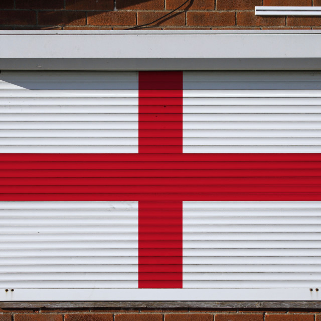 """""""England flag on closed security shutters"""" stock image"""