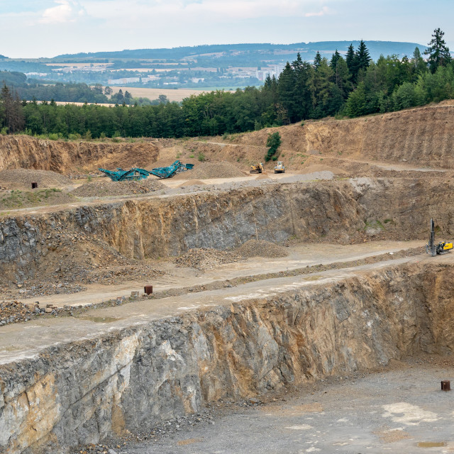 """Opencast mining quarry with lots of machinery. Mining in the gra"" stock image"
