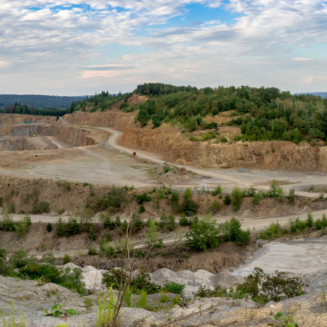 """Panorama of opencast mining quarry with machinery. Quarrying of"" stock image"