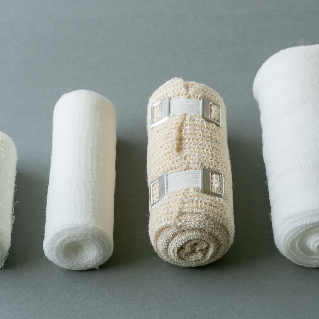 """Different sizes of medical bandages. Medical bandages on grey ba"" stock image"