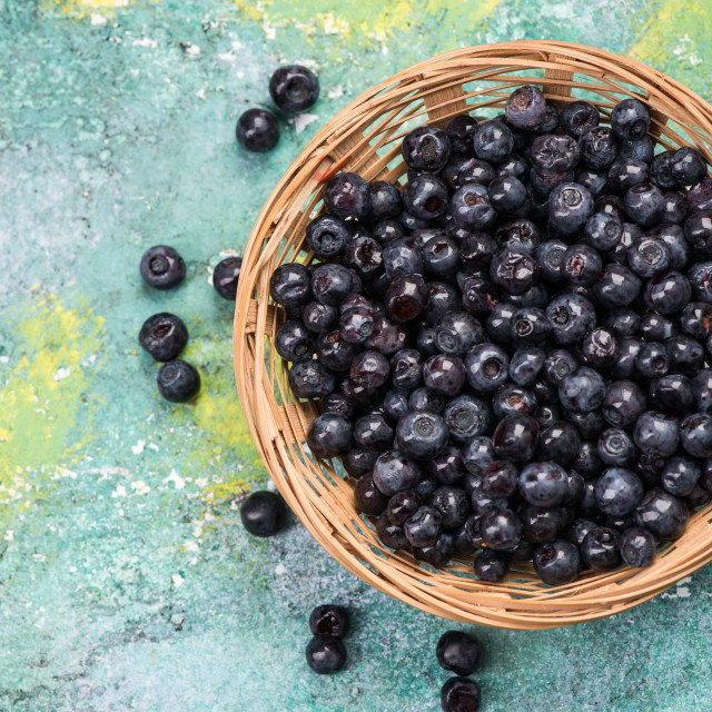 """""""Fresh ripe blueberry in basket, copy space on wooden board"""" stock image"""